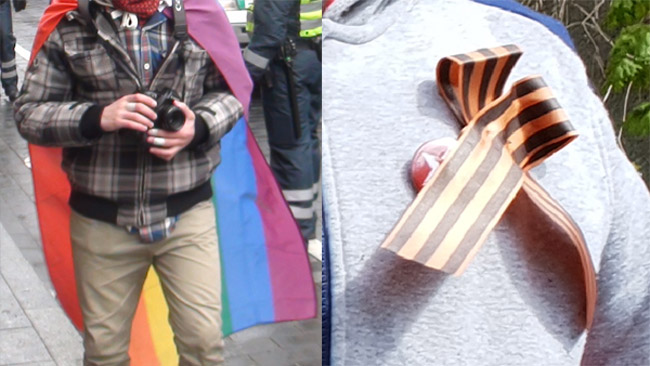 A person wearing a Rainbow flag (left) and a St. George strip (right). Both pictures taken during mass events: the Rainbow flag is used in a protest against Lithuanian independence day celebrations (many LGBT activists in Lithuania see Lithuanian patriotism as a negative hindrance to the propagation of Western values), while St. George strip is used in a Soviet victory day celebration