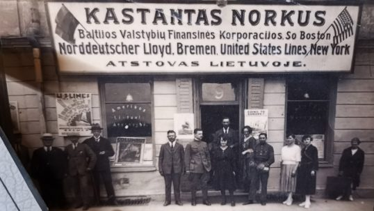 A typical Lithuanian emigration bureau in a Lithuanian city. At this time, emigration became a planned affair with even a Law on Emigration drafted. Lithuanians would typically get a complete service of traveling from Vilnius to a place of emigration, combining trains and ships, and this was a more orderly affair now