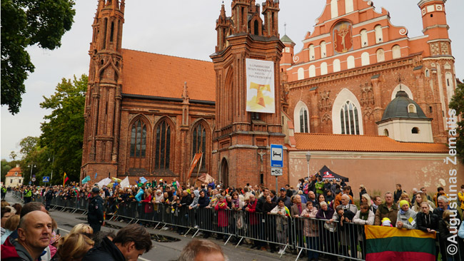 Lithuanians line up to greet pope along the famous St. Ann church in Vilnius